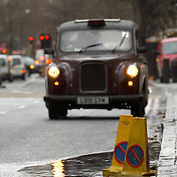 London taxi in rainy weather