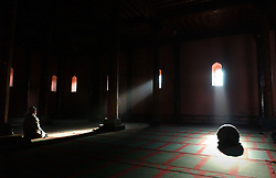 Kashmiri men pray inside the Jama Masjid mosque during Ramadan in Srinagar, the summer capital of the state of Kashmir in India, November 20.  Kashmir has seen over 900 civilians killed this year and 1,765 wounded in a brutal conflict that the United Nations once called the most dangerous place in the world.