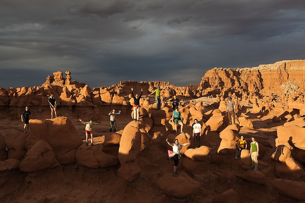 Students from the University of Colorado stand on boulders and hoodoos on a geology field trip to Goblin Valley State Park, Utah.