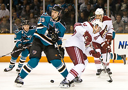 April 10, 2010; San Jose, CA, USA; San Jose Sharks left wing Ryane Clowe (29) knocks Phoenix Coyotes defenseman Sami Lepisto (18) off the puck during the second period at HP Pavilion. San Jose defeated Phoenix 3-2 in a shootout. Mandatory Credit: Jason O. Watson / US PRESSWIRE