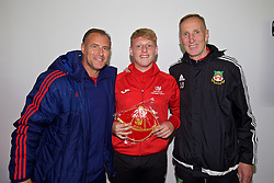NEWPORT, WALES - Sunday, May 22, 2016: Keane Thomas is presented with his cap by former Wales players Clayton Blackmore [L] and Joey Jones [R] during the Football Association of Wales' National Coaches Conference 2016 at Dragon Park FAW National Development Centre. (Pic by David Rawcliffe/Propaganda)