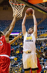 Dec 20, 2016; Morgantown, WV, USA; West Virginia Mountaineers forward Maciej Bender (25) attempts to dunk during the second half against the Radford Highlanders at WVU Coliseum. Mandatory Credit: Ben Queen-USA TODAY Sports