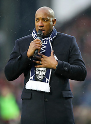 Retired footballer Dion Dublin speaks to the crowd during a tribute to Cyrille Regis