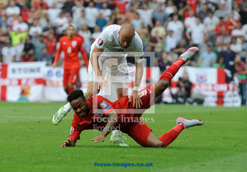 Miso Brecko of Slovenia and Raheem Sterling of England during the UEFA Euro 2016 Qualifying match at Stozice Stadium, Ljubljana<br /> Picture by Stefano Gnech/Focus Images Ltd +39 333 1641678<br /> 14/06/2015
