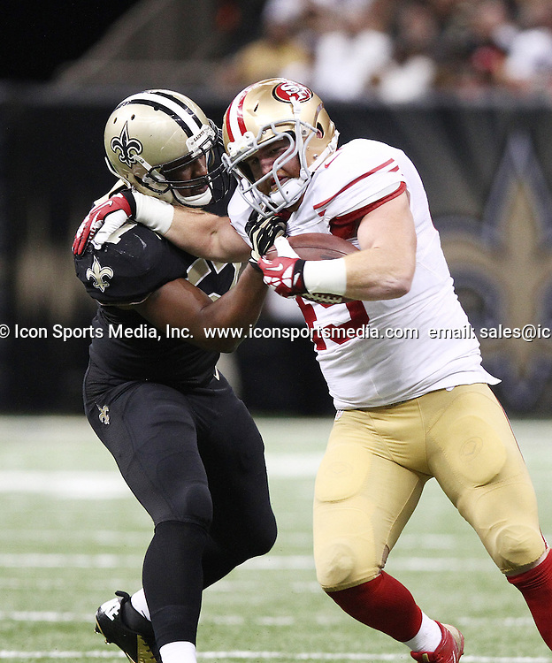 Nov. 17, 2013 - New Orleans, LOUISIANA, US - New Orleans Saints DAVID HAWTHORNE tries to take down San Francisco 49ers full back BRUCE MILLER at the Louisiana Superdome in New Orleans, Louisiana on Sunday November 17, 2013. The Saints beat the 49ers 23-20