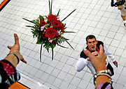 USA swimmer Michael Phelps throws his bouquet of flowers to his mother Debbie after winning the Men's 200m IM swimming finals, his 6th gold medal of the Games, at the National Aquatics Center during the Summer Olympics in Beijing, China on Friday, August 15, 2008. <br /> &quot;Flower Power&quot;