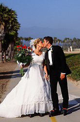 bride and groom on rollerblades in Santa Barbara, CA