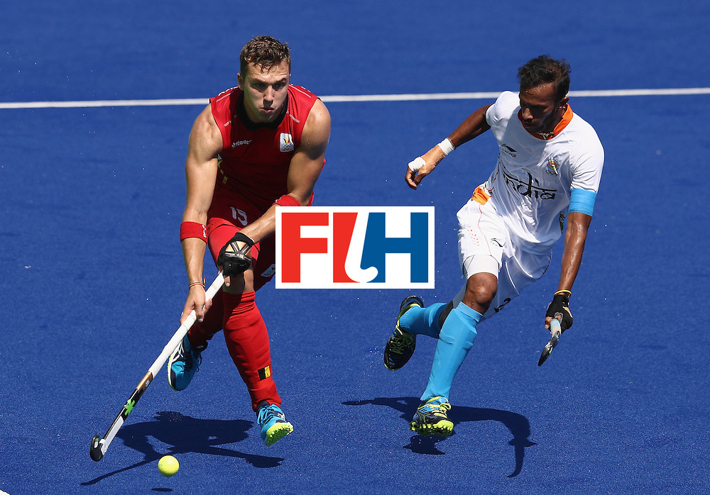 RIO DE JANEIRO, BRAZIL - AUGUST 14:  Emmanuel Stockbroekx of Belgium moves away from Akashdeep Singh during the Men's hockey quarter final match between Belgium and India on Day 9 of the Rio 2016 Olympic Games at the Olympic Hockey Centre on August 14, 2016 in Rio de Janeiro, Brazil.  (Photo by David Rogers/Getty Images)
