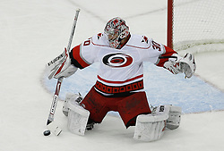 Apr 15, 2009; Newark, NJ, USA; Carolina Hurricanes goalie Cam Ward (30) makes a save during the second period of game one of the eastern conference quarterfinals of the 2009 Stanley Cup playoffs against the New Jersey Devils at the Prudential Center.
