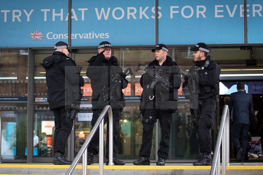 © Licensed to London News Pictures . 02/10/2017. Manchester, UK. Armed police guarding the conference , at the start of the second day of the Conservative Party Conference at the Manchester Central Convention Centre . Photo credit: Joel Goodman/LNP