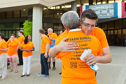 Chris Hartman, director of the Fairness Campaign, right, hugs U.S. Congressman John Yarmuth before entering the 53rd Annual Kentucky Farm Beureau Country Ham Breakfast. The annual charity event was protested by Yarmuth, Hartman and other members of various fairness organizations outside the South Wing of the Kentucky Fair and Exposition Center, Thursday, Aug. 25, 2016 in Louisville.