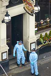 **PREVIOUSLY UNSEEN PICTURES** <br /> &copy; Licensed to London News Pictures. 04/06/2017. LONDON, UK.  General view of forensic officers investigating the scene outside the Barrowboy and Banker pub on London Bridge near where Khuram Butt, Rachid Redouane and Youssef Zaghba murdered at least eight people in a terror attack. Photo credit: Cliff Hide/LNP
