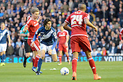 Birmingham City striker Diego Fabbrini skips away from Middlesbrough midfielder Grant Leadbitter during the Sky Bet Championship match between Birmingham City and Middlesbrough at St Andrews, Birmingham, England on 29 April 2016. Photo by Alan Franklin.