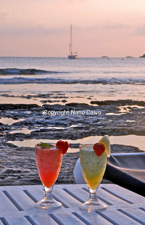 Sunset, relax and cocktails in Salinas Beach, Ibiza