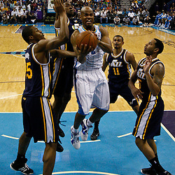 April 11, 2011; New Orleans, LA, USA; New Orleans Hornets point guard Jarrett Jack (2) shoots between four Utah Jazz defenders during the first half at the New Orleans Arena.  Mandatory Credit: Derick E. Hingle