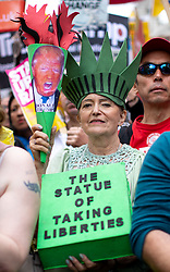 © Licensed to London News Pictures. 04/06/2019. London, UK. Demonstrators protest on Whitehall against the President of the United States of America, who was in Downing Street having a meeting with British Prime Minister Theresa May as part of a state visit to the UK. Photo credit : Tom Nicholson/LNP