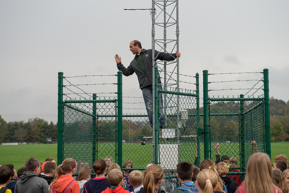 Dr. Ryan Fogt explains various weather instruments installed at the West State Street Weather Station to Nelsonville- York Elementary school students. Photo by Ben Siegel