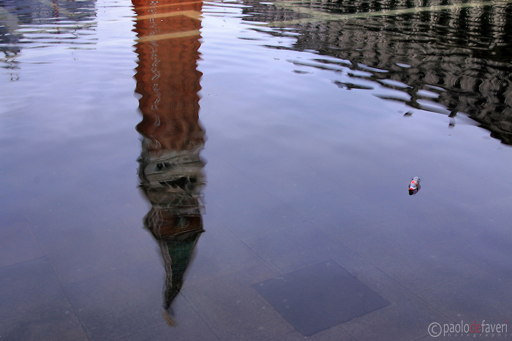 "The bell tower of San Marco reflected in the tide waters. Taken on an early morning at the end of January when the rising tide had already completely flooded the city, producing that phenomenon known as ""acqua alta""."