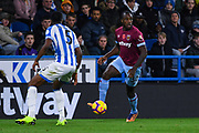 Michail Antonio of West Ham United (30) looks to take on Terence Kongolo of Huddersfield Town (5) during the Premier League match between Huddersfield Town and West Ham United at the John Smiths Stadium, Huddersfield, England on 10 November 2018.
