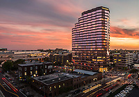Architectural photography of downtown Tampa Florida's Wells Fargo Building. At sunset, the warm lights of the interior play well with the dramatic colors of the Florida sunset.