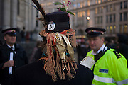 Activist speaks with police officers on the 11th day of the Occupy London protest camp in St Paul's cathedral churchyard, London 26/11/11. City lawyers are using medieval pedestrian bylaws to gain a court injunction to evict the activists who set up tents and shelters as in other countries.