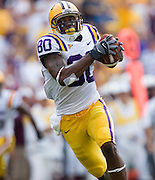 Baton Rouge, LA - SEPTEMBER 30:  Dwayne Bowe #80 of the LSU Tigers runs with the ball after making a catch against the Mississippi State Bulldogs at Tiger Stadium on September 30, 2006 in Baton Rouge, Louisiana.  The Tigers defeated the Bulldogs 48 - 17.  (Photo by Wesley Hitt/Getty Images) *** Local Caption *** Dwayne Bowe