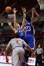 07 January 2015:  Mark Hall watches a bounding ball as it passes the hands of Ore Arogundade and Kory Kuenstling  during an NCAA MVC (Missouri Valley Conference) men's basketball game between the Drake Bulldogs and the Illinois State Redbirds at Redbird Arena in Normal Illinois.  Illinois State comes out victorious 81-45.