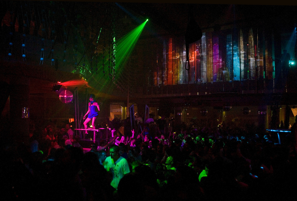 A woman dancing on a stage at Eden nightclub in San Antonio, Ibiza. Eden Ibiza started in 1999, and was built where the previous Kaos nightclub stood.