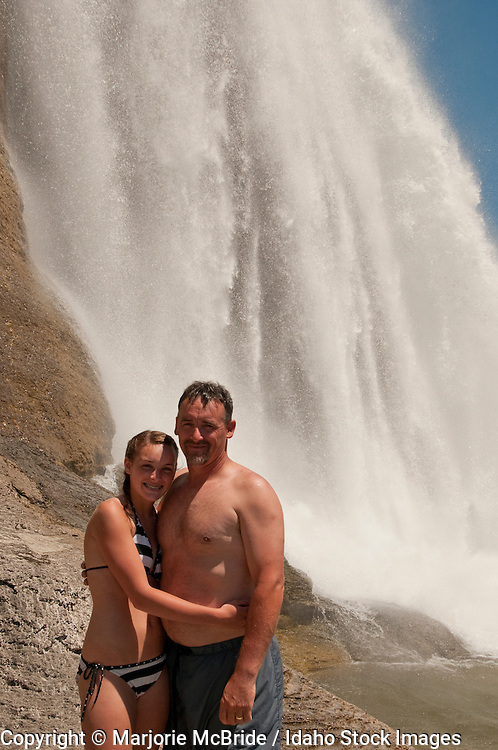 Father and daughter below Shoshone Falls a large waterfall on the Snake River in Twin Falls, Idaho.