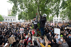 © Licensed to London News Pictures. 06/06/2020. London, UK. Protesters kneel for a minutes silence in a demonstration in Parliament Square organised by group Black Lives Matter for the American George Floyd who died whilst being arrested by US policemen Derek Chauvin. His death has caused civil unrest in some US cities. Photo credit: Ray Tang/LNP