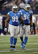Detroit Lions defensive tackle C.J. Mosley (99) and Detroit Lions defensive end Ezekiel Ansah (94) look on between plays during the NFL week 18 NFC Wild Card postseason football game against the Dallas Cowboys on Sunday, Jan. 4, 2015 in Arlington, Texas. The Cowboys won the game 24-20. ©Paul Anthony Spinelli