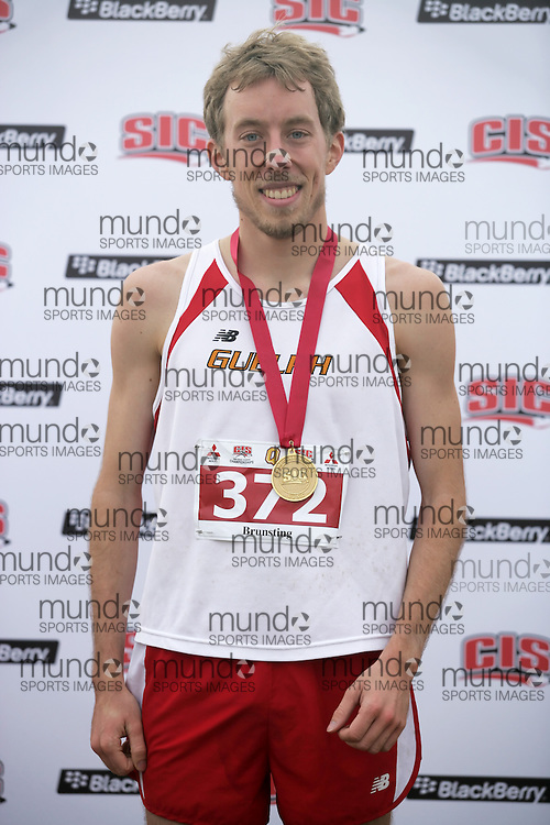 (Kingston, Ontario -- 14 Nov 2009) Matt Brunsting of the University of Guelph receives his gold medal at the 2009 Canadian Interuniversity Sport CIS Cross Country Championships at Forth Henry Hill in Kingston Ontario. Photograph copyright Sean Burges / Mundo Sport Images, 2009..