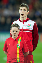 CARDIFF, WALES - Friday, October 12, 2012: Wales' Ben Davies wearing a pink ribbon for missing five-year girl from Machynlleth April Jones before the Brazil 2014 FIFA World Cup Qualifying Group A match against Scotland at the Cardiff City Stadium. (Pic by David Rawcliffe/Propaganda)