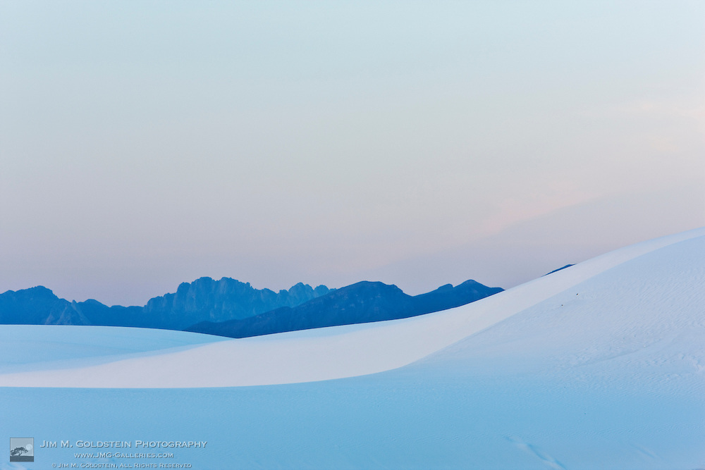 Sand dunes at sunet with the San Andreas Mountains in the background - White Sands National Monument, New Mexico