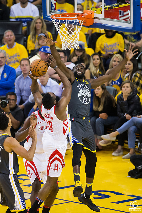 Golden State Warriors forward Draymond Green (23) attempts to block a shot by Houston Rockets guard James Harden (13) during Game 4 of the Western Conference Finals at Oracle Arena in Oakland, Calif., on May 22, 2018. (Stan Olszewski/Special to S.F. Examiner)