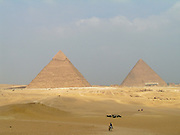 Tourists horse back riding in the Giza Plateau near the Great Pyramids of Egypt, Giza, Egypt