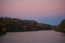 The sky is lit with soft pink evening light as the sun goes down over the Sale River on the Kimberley coast in Western Australia.  The Sale River empties into Doubtful Bay.