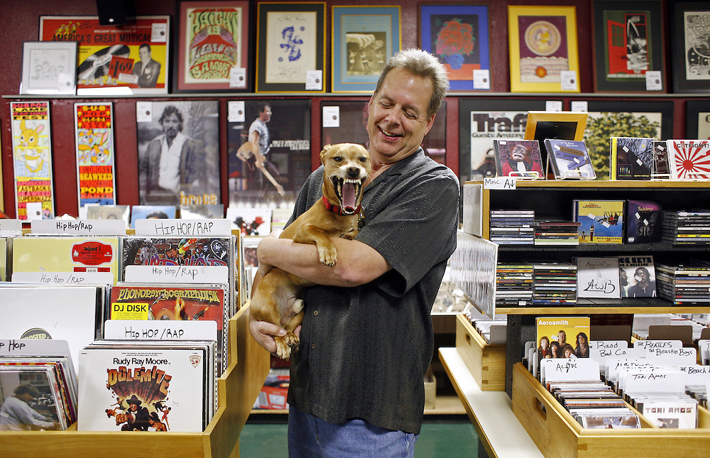 Ranch Records owner Kit Close is photographed with his dog, Newman.