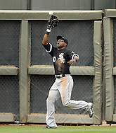 SURPRISE, AZ - MARCH 06:  Alejandro De Aza #30 of the Chicago White Sox makes a catch in left field against the Kansas City Royals on March 6, 2014 at The Ballpark in Surprise in Surprise, Arizona. (Photo by Ron Vesely)   Subject: Alejandro De Aza
