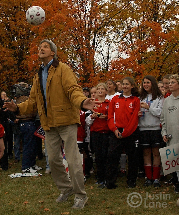 United States Senator and Democratic Candidate for President John Kerry, center, kicks a soccer ball during a a visit with a gathering of girls soccer teams at Brown Deer Park in Brown Deer, WI on Friday, 15 October 2004. Kerry is making campaign stops today in Wisconsin and Ohio, both battleground states in this year's presidential election, taking place on 2 November...EPA/JUSTIN LANE