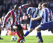 .Photo Peter Spurrier.06/04/2002.Nationwide Div 2.Brentford vs Huddersfield - Griffen Park:.Lloyd Owusu, attacking the Huddersfield defenders..