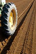 Israel, Negev Desert, Tractor plants seeds in a field