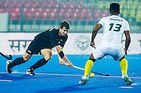 LUCKNOW (India) -   Junior World Cup hockey  U21 for men . SOUTH AFRICA v NEW ZEALAND (9/10 place) . David Brydon (NZL) with Khumo Mokale (RSA)   COPYRIGHT  KOEN SUYK