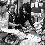 Eritrean women talk about their hembeshas (a traditional bread made with fenugreek, cardamon, coriander, among others) The Eritrean community in Montreal gathers every Saturday afternoon to celebrate, play and share stories. (Oscar Aguirre)