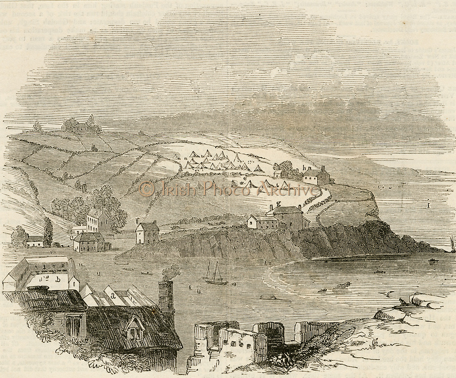 'Mevagissy, Cornwall, England, during the Cholera epidemic of 1849, showing the Board of Health tents in the background.  Woodcut, August 1849.t'
