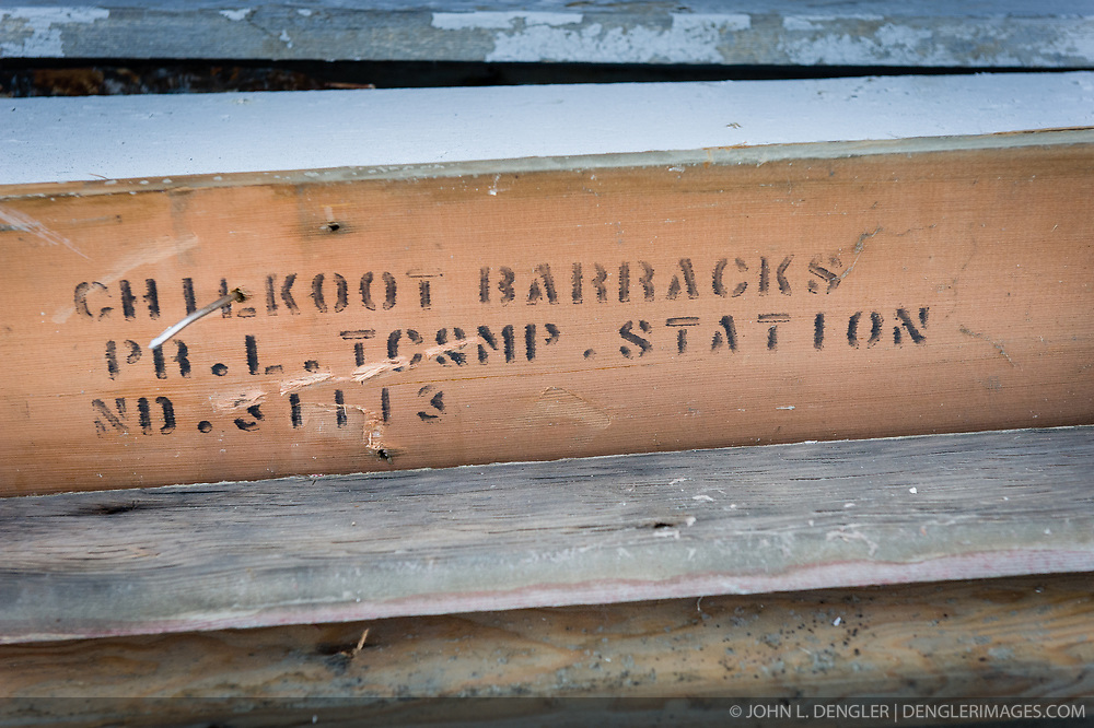 A board that was covered by siding reveals a stenciled label was uncovered during the restoration of the fire hall located on the grounds of the former U.S. Army post, Fort William H. Seward in Haines, Alaska. Through the years, the historic Fort Seward area has been referred to as Fort William H. Seward, Chilkoot Barracks, and Port Chilkoot.<br /> <br /> According to the National Historic Landmarks register the fort was &quot;established by Executive Order on December 31, 1898, and first known as Haines Mission, Fort Seward was the last of 11 military posts established in Alaska during the territory's gold rushes between 1897 and 1904. Founded for the purpose of preserving law and order among the gold seekers, the fort also provided a U.S. military presence in Alaska during boundary disputes with Canada. The only active military post in Alaska between 1925 and 1940, the fort was closed at the end of World War II.&rdquo; <br /> <br /> Through the years, the historic Fort Seward area has been referred to as Fort William H. Seward, Chilkoot Barracks, and Port Chilkoot.<br /> <br /> The fire hall was restored over a two-year period by owners Joanne Waterman and Phyllis Sage who also own the fort&rsquo;s original guardhouse located next door to the fire hall. That building, now known as the Alaska Guardhouse, is a bed and breakfast.