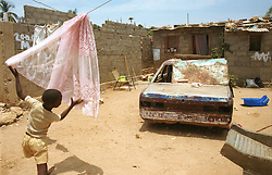 Homes that Angolans live in are in sharp contrast to the homes for foreigners and government officials in the capital of Luanda in Angola in this file photo.  President Jose Eduardo dos Santos, who has led Angola since 1979, said he would not run in presidential elections planned for next year.  Angola's brutal 26 year-civil war has displaced around two million people - about a sixth of the population - and 200 die each day according to United Nations estimates. .(Photo by Ami Vitale)