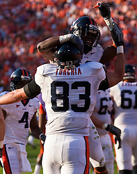 November 21, 2009; Clemson, SC, USA; Virginia Cavaliers wide receiver Vic Hall (4) and tight end Joe Torchia (83) celebrate after scoring a touchdown against the Clemson Tigers during the second quarter at Memorial Stadium.  Clemson defeated Virginia 34-21.