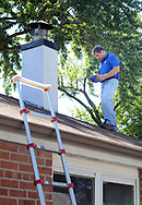 Home inspector Frank Castiglione of Real Estate Inspections, looks at the roof of a home for possible problems Thursday, September 28, 2017 in Plymouth Meeting, Pennsylvania. (WILLIAM THOMAS CAIN / For The Philadelphia Inquirer)