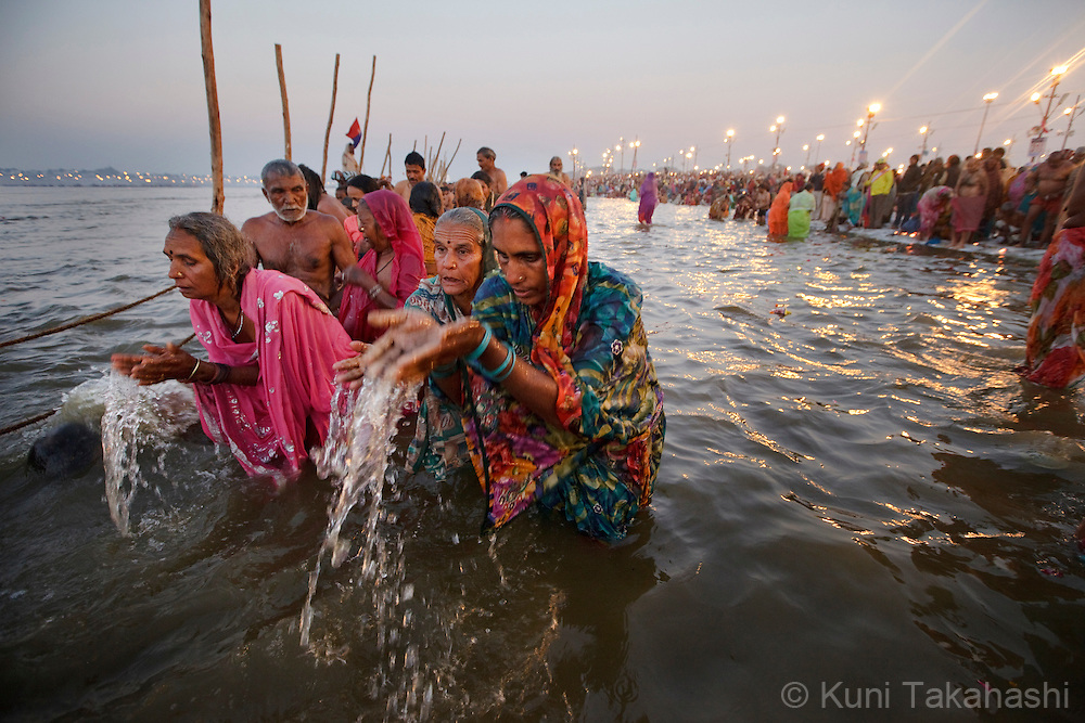 Hindu devotees take bath in holy Ganga River during Kumbh Mela in Allahabad in India on Feb 8, 2013. Up to100 million worshippers gather over 55 days of the biggest Hindu religious event in the world to take a ritual bath in the holy waters, believed to cleanse sins and bestow blessings. <br /> (Photo by Kuni Takahashi)